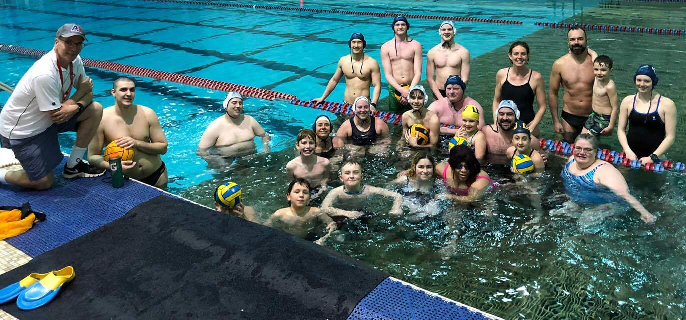 Team gathers for a photo after practices at the CV pool bulkhead.